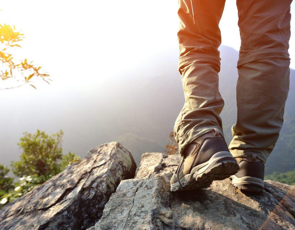 hiking feet mountain peak rock